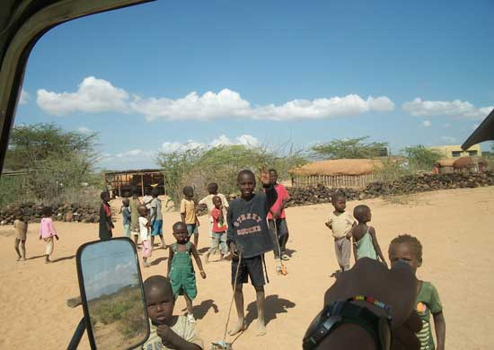 Children gathering outside of Umoja Uaso Women's Group village when they see Bushka pull up. Photo by Cece Wildeman